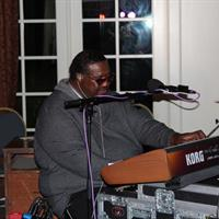 Melvin Seals plays the keys at the Cronin wedding reception at AGCC