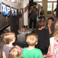 Kid's Birthday Party with Star Wars theme.  Note special custom Millennium Falcon Star Wars birthday cake