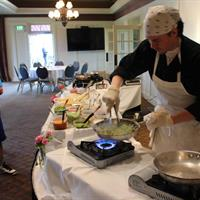 TJ cooking up food at Sunday Fun-Day